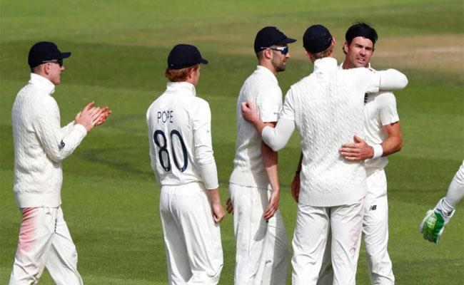 ames Anderson Forgets Social Distancing Guidelines During Wicket Celebration - Sakshi