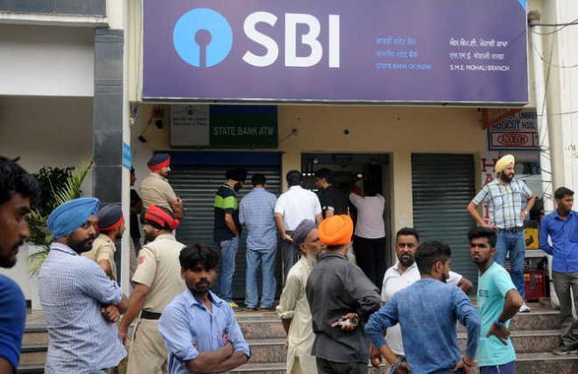 Son of ex-bank staffers among three held for running fake SBI branch - Sakshi