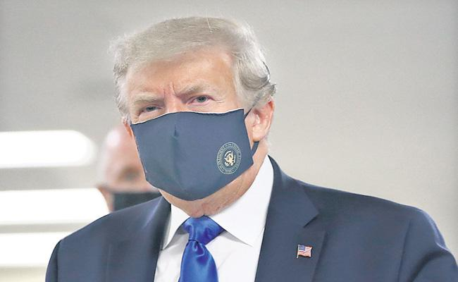 US President Donald Trump wears face mask for the first time - Sakshi