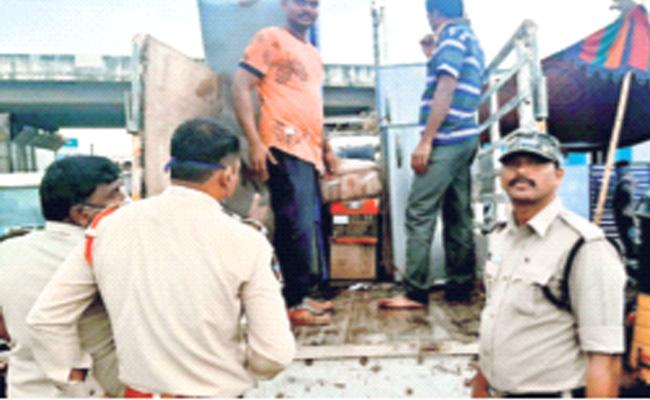 Alcohol Bottles Found in Goods Vehicles Krishna - Sakshi