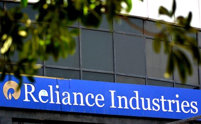 Reliance Ind becomes the 1st Indian co to have top mcap  - Sakshi