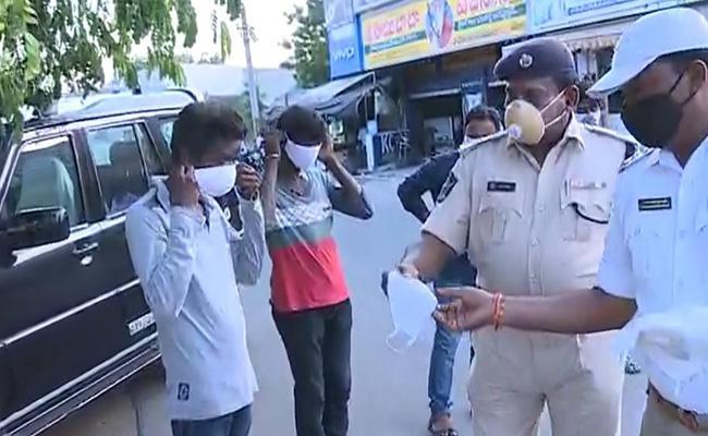 Vijayawada Police Are Imposing Fines Who Dont Follow Covid Rules - Sakshi