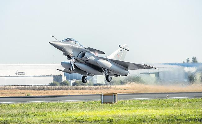 Five Rafale jets leave for India - Sakshi