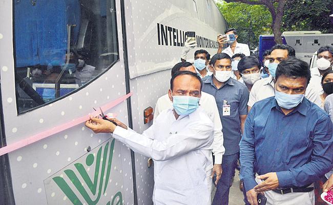 Coronavirus: Mobile testing labs into the field in Telangana - Sakshi