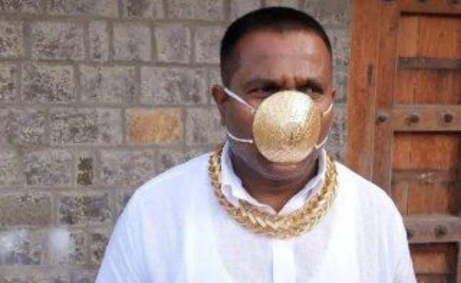 Pune Man Wears Gold Mask - Sakshi