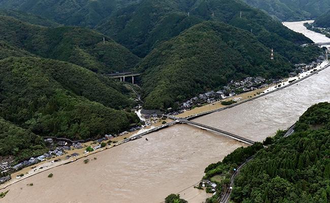 Heavy Rain Floods In Southern Japan Two Dead Over Dozens Missing - Sakshi