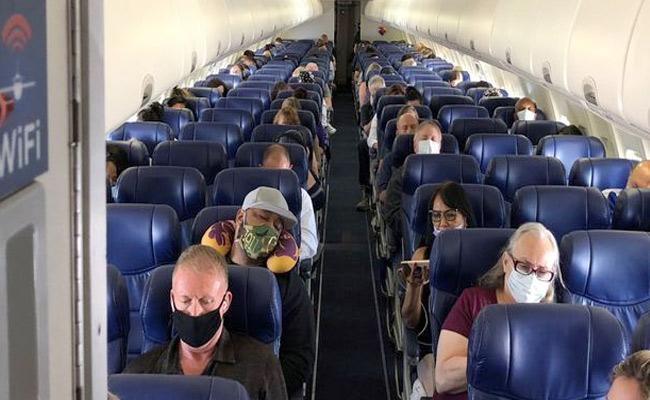 You have To Wear A Mask On A Plane Says US Airlines - Sakshi