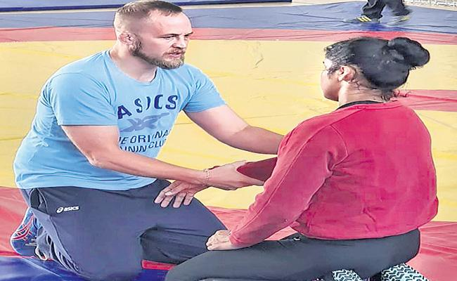 Indian Womens Wrestling Coach Andrew Cook Wants Explanation About His Suspension - Sakshi