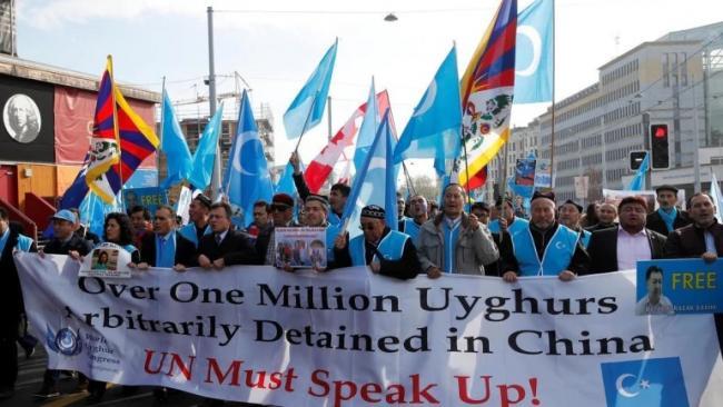 Uighur Groups Take China to International Criminal Court - Sakshi