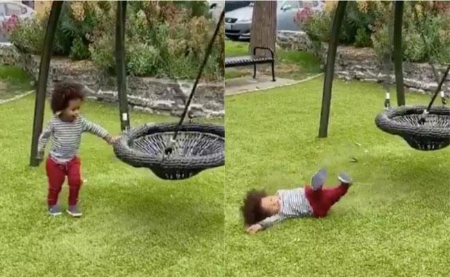 Video Of Baby Fake Falling After Touching A Swing Becoming Viral  - Sakshi