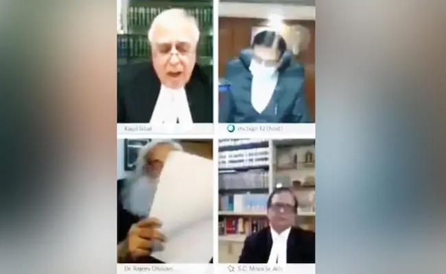 Senior Advocate Smokes Hookah During Hearing - Sakshi