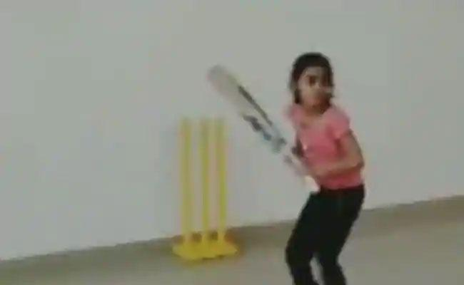 7 Year Old Girl Plays Dhonis Helicopter Shot Goes Viral - Sakshi