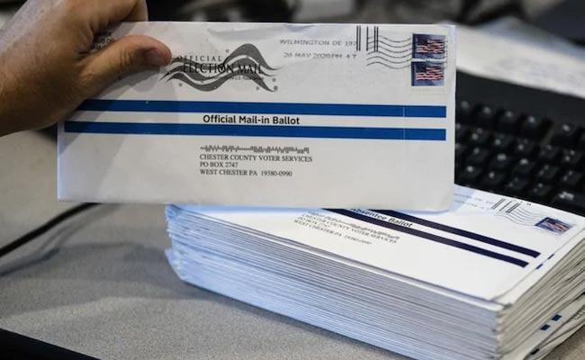 US Postal Service Warns 46 States Over Mail Voting - Sakshi