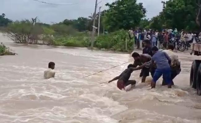 Bike lashes into Flood water in Sydapur - Sakshi