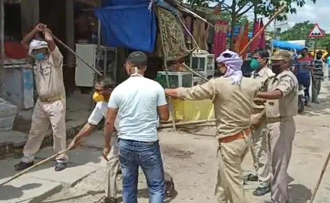 UP Official Thrashed Mask Clad Men During Checking Drive - Sakshi