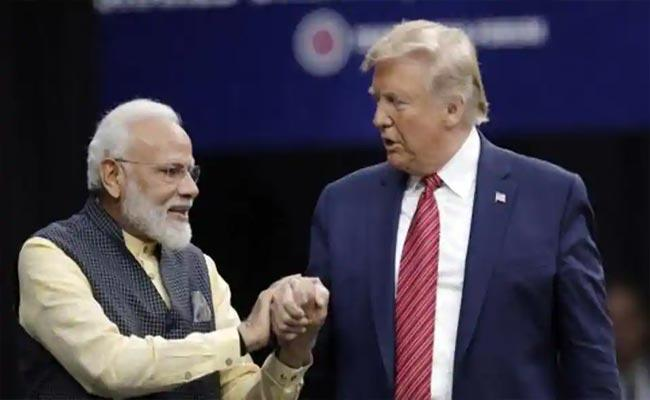 Trump Campaign woos Indian Americans With Howdy Modi Namaste Trump - Sakshi