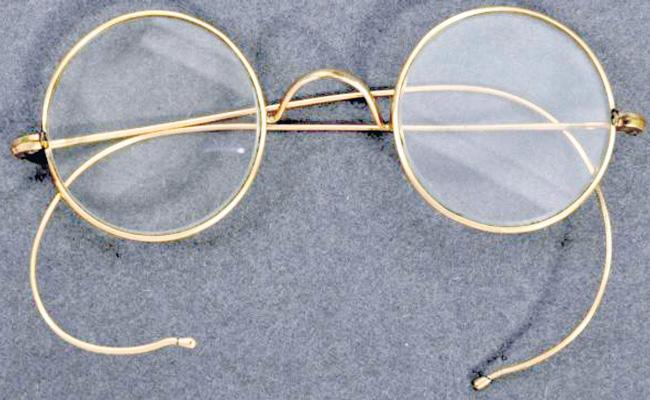 Mahatma Gandhi gold-plated spectacles sell for a record price - Sakshi