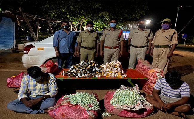 Illegal Liquor Transport In Jasmine Flower Bags In Anantapur - Sakshi