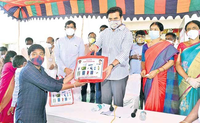 KTR Distributing Coronavirus Kits At Rajanna Sircilla - Sakshi