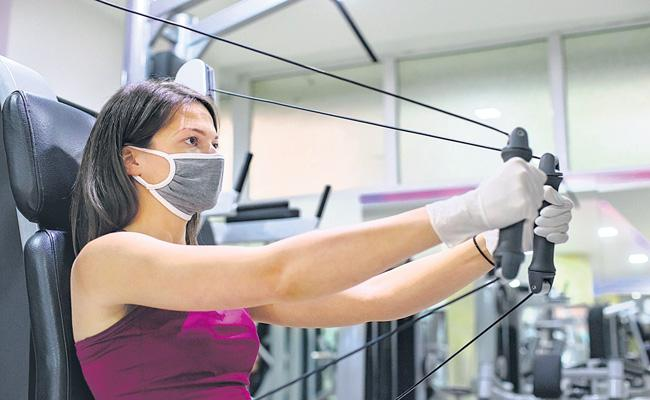 Govt issues guidelines for reopening of gyms, yoga institutes - Sakshi