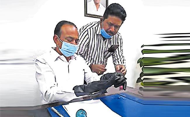 Security Agency Innovated Sanitizer Hand Gloves in Hyderabad - Sakshi