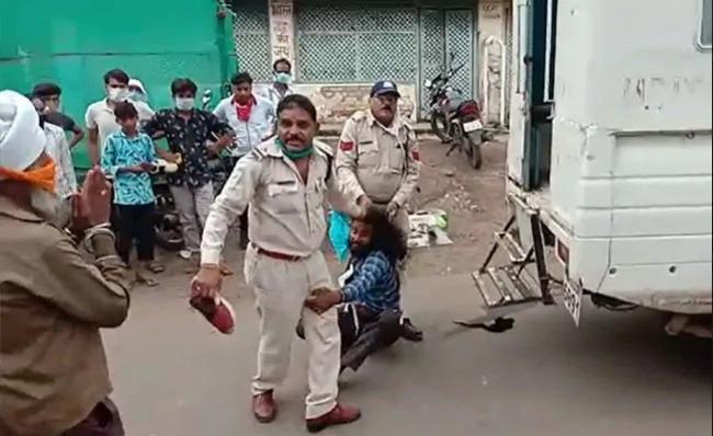 Madhya Pradesh Cops Drag Sikh Man By Hair Thrash Him - Sakshi