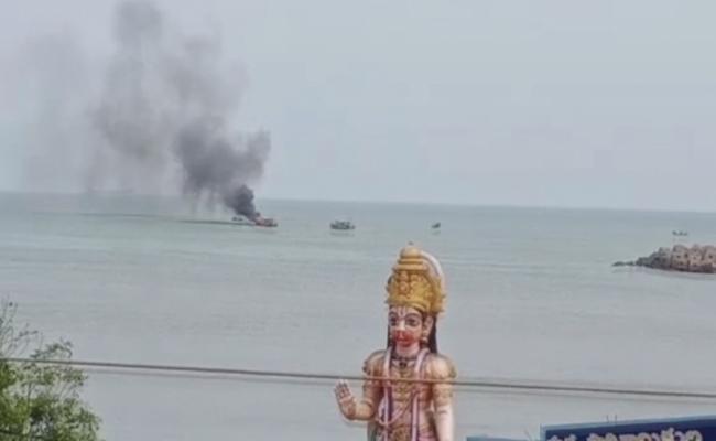 Fishing Boat Catches Fire While Returning To Visakhapatnam Port - Sakshi