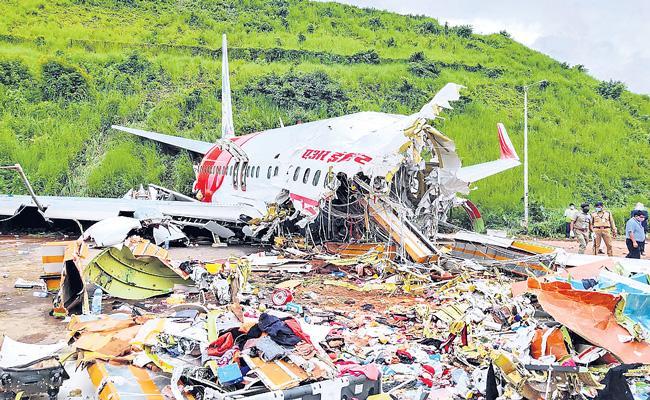 Air India Express Plane Crash on runway in Kerala - Sakshi