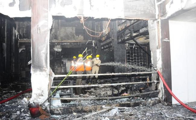 Fire Accident In Swarna Palace Hotel Vijayawada - Sakshi