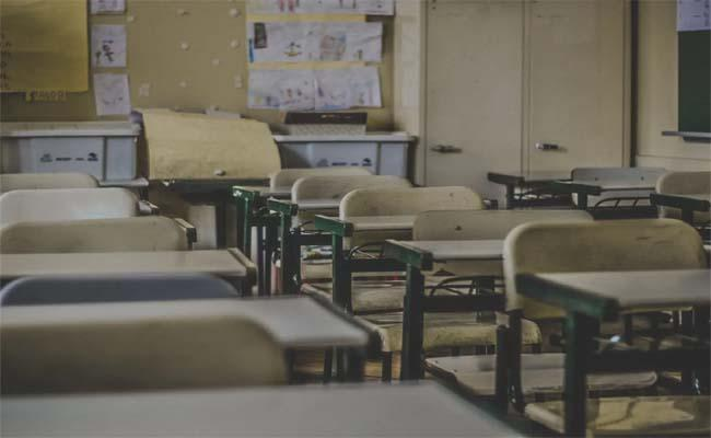 Fake Coughing, Crack Jokes On Coronavirus Punishable IN UK Schools - Sakshi