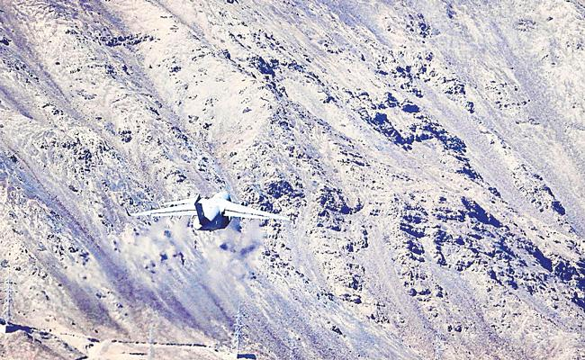 Indian and Chinese troops man remote border outposts just hundreds of metres a part - Sakshi