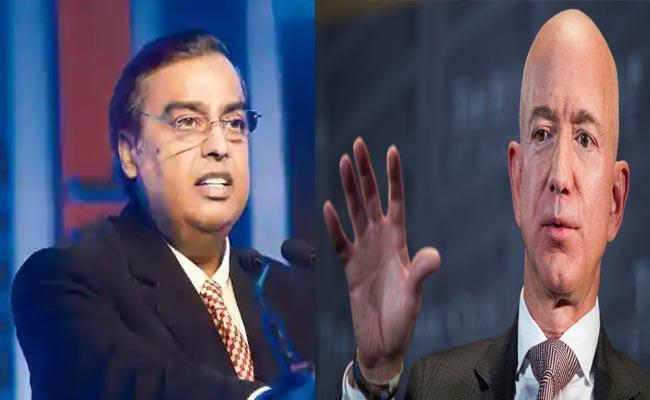 Reliance offers usd 20 billion-stake to Amazon in retail arm - Sakshi
