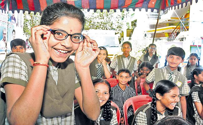 AP Govt Authorities are preparing to send the eye glasses to children home - Sakshi