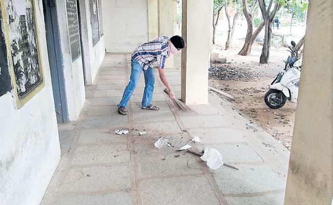Teachers Cleaning The Government Schools At ZPHS Devanpally Telangana - Sakshi