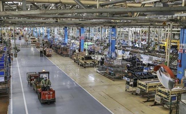 Toyota Motors halts expansion plans in India, blames high tax regime - Sakshi