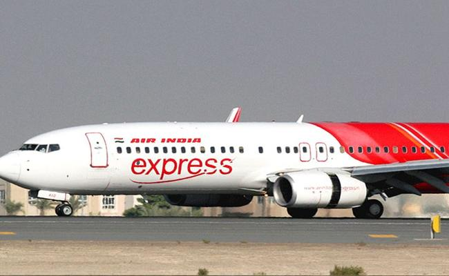 Dubai suspends Air India Express operations for COVID-19 passenger - Sakshi