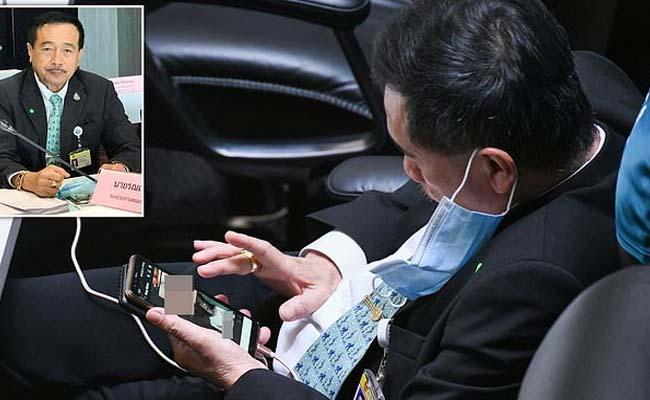Thailand MP Caught Looking Porn on Phone During Budget Meeting - Sakshi