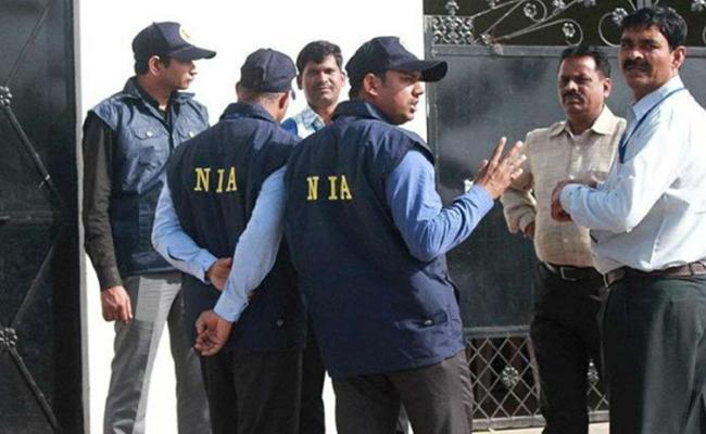 NIA arrests 9 Al Qaeda terrorists In Bengal Kerala - Sakshi