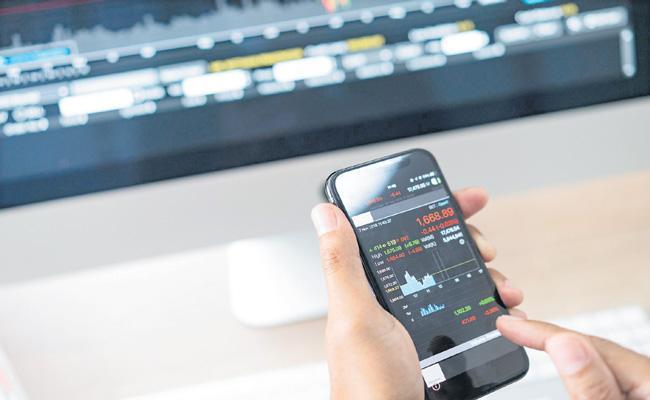 Stock trading via mobile phones grows during coronavirus - Sakshi