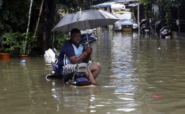 Mumbai Flooded After Heavy Overnight Rain IMD Warning - Sakshi