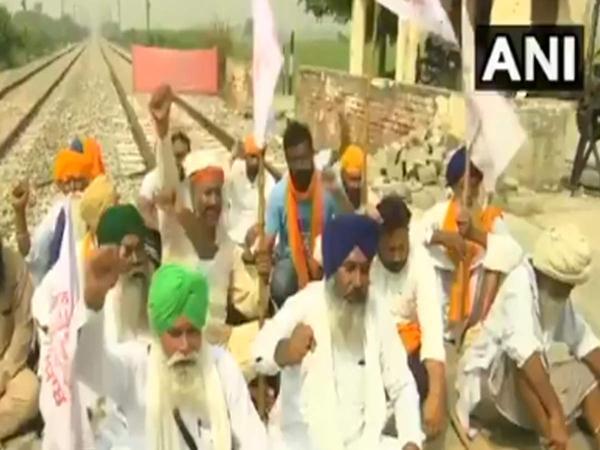 Farmers Hold Rail Roko In Amritsar In Protest Against Farm Bills - Sakshi