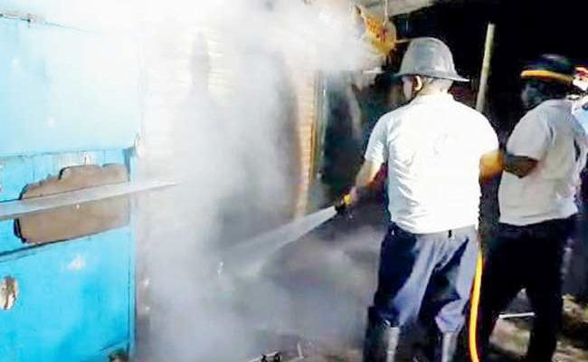 Young Man Sets Girl Friends Father Shop On Fire - Sakshi