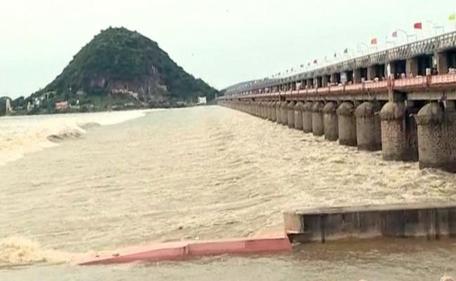 Heavy Flood Water Reaches Prakasam Barrage - Sakshi