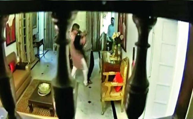 DG rank officer assaults wife video captured on CCTV - Sakshi
