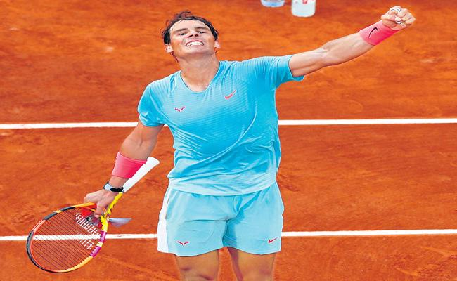 Rafael Nadal reached his 13th French Open final - Sakshi