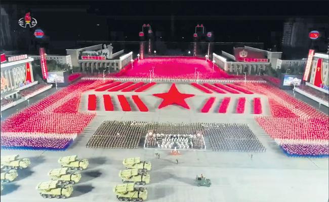 Kim Jong Un Puts New Missiles On Display At Military Parade in North Korea - Sakshi