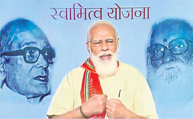 PM Modi launches physical distribution of property cards under SVAMITVA scheme - Sakshi