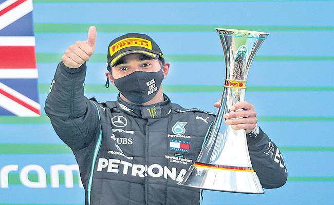 Lewis Hamilton equals Michael Schumacher 91 race wins at Eifel F1 Grand Prix - Sakshi