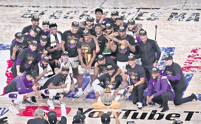 Los Angeles Lakers beat Miami Heat to claim record - Sakshi