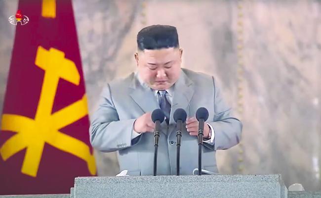 Kim Jong-un wipes away tears during rare apology to North Koreans - Sakshi